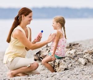 Mom Applying Daughter's Sunscreen