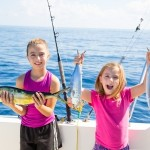 girls catching their first fish on a fishing charter